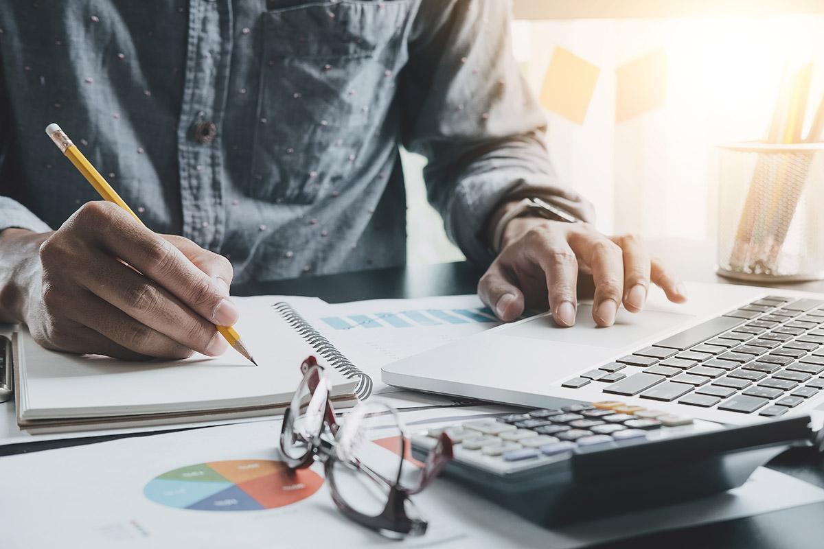 man at a desk writing